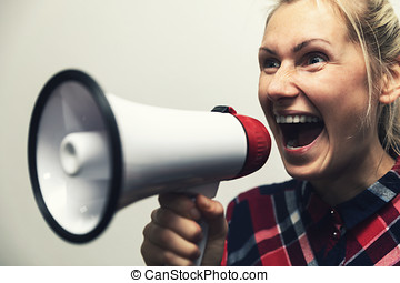angry shouting woman with megaphone in hand
