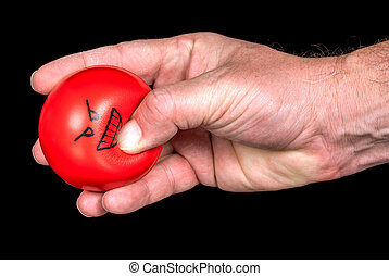 Angry stress ball is squeezed by a hand