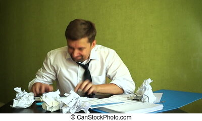 Angry stressed businessman smashing keyboard. Stress at a...