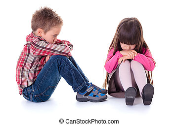 Angry sulking children sitting on the floor - Angry sulking...