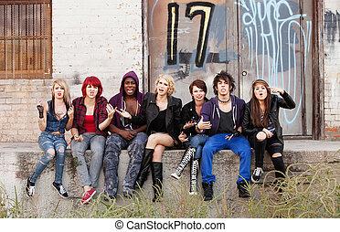 Angry teen punks shout at the camera