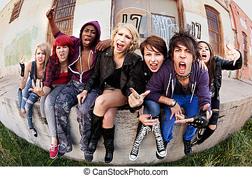 Angry teen punks shout towards the camera