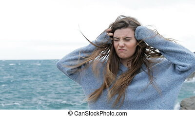 Angry teen with tousled hair in a windy day - Angry teen ...