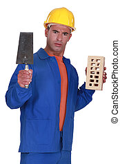 Angry tradesman holding a brick and trowel