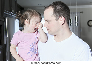 Angry upset girl with father inside the house