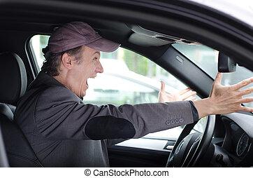 Angry upset man at wheel driving his car screaming - Angry ...