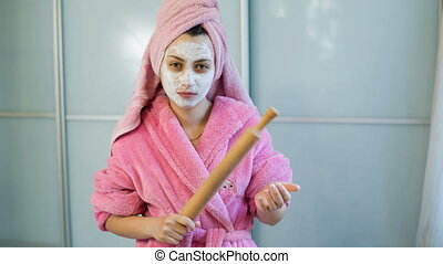 beautiful angry girl with rolling-pin