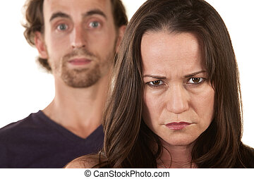 Angry Woman and Innocent Man - Angry Caucasian woman...