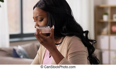 angry woman calling on smartphone at home office - remote ...