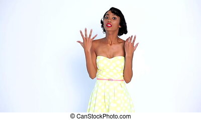 Angry woman gesturing and pointing on white background
