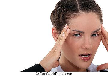 angry woman having a headache
