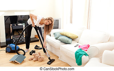 Angry woman in a living room - Angry woman in a chaotic...