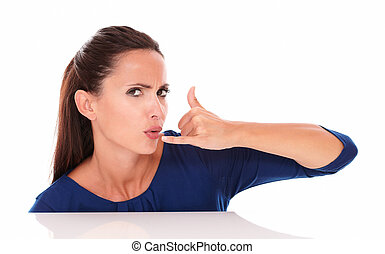 Angry woman in blue shirt gesturing a call