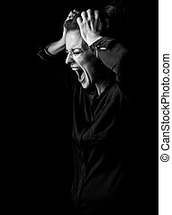 angry woman in dark dress isolated on black background