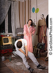 Angry Woman Pointing her Seated Sleeping Partner