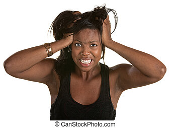 Desperate young African woman pulling on her hair