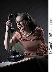 Angry woman screaming at retro phone, 1950 style