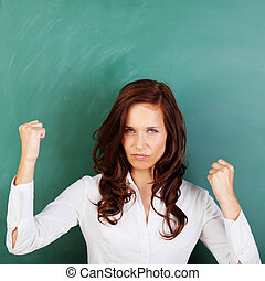 Angry woman shaking her fists