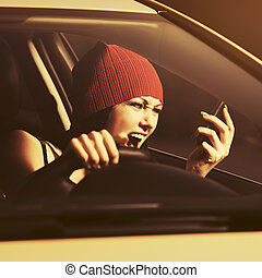 Angry woman shouting on cell phone driving a car