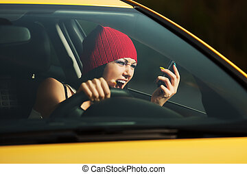 Angry woman shouting on the cell phone in a car