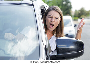 angry woman shouting out of a car window