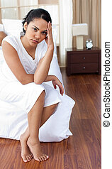 Angry woman sitting on the bed