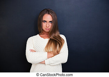 Angry woman standing with arms folded