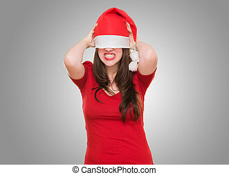 angry woman with a christmas hat covering her eyes