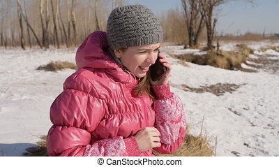 Angry woman with a phone outdoors