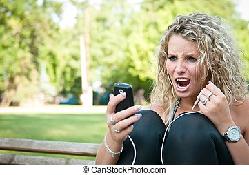 Angry - woman with cellphone