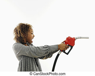 Angry woman with gas nozzle - Portrait of pretty young woman...