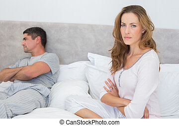 Angry woman with man in bed