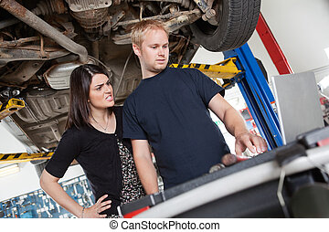 Angry woman with mechanic