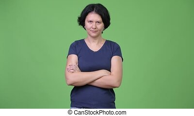 Angry woman with short hair crossing arms