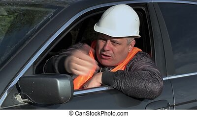 Angry worker in car on road