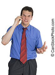 Angry young businessman talking on mobile phone