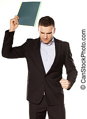angry young businessman with folder