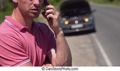 Angry Young Man Calling The Emergency Via Phone - An Angry...