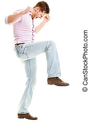Angry young man smashing something - isolated on white backgroun