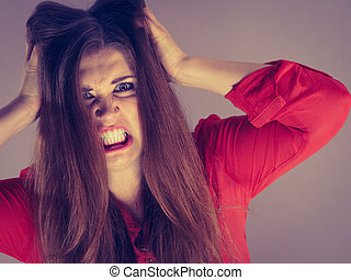 Angry pretty attractive woman being pissed off. Very frustrated lady having brown hair.
