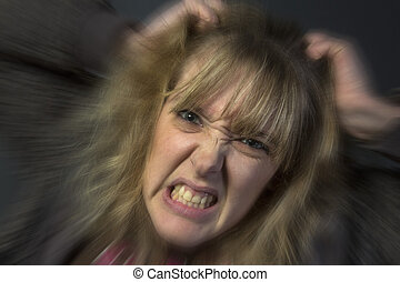 Angry Young Woman - A very angry young woman tearing her...