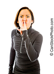 Angry young woman with a finger on lips