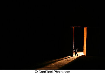 angst - a man inside a door with dramatic light