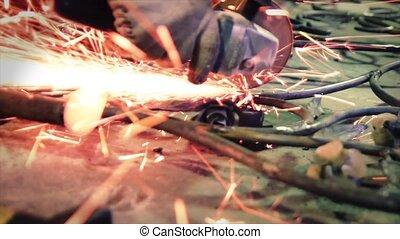 Angular grinding machine workflow - blacksmith working with...