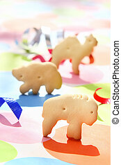Animal crackers standing on a festive background