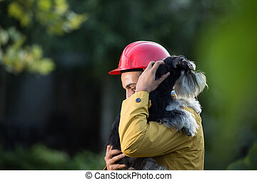 Animal rescue guard - Young man in raincoat and with helmet ...