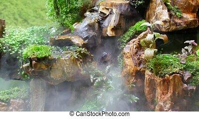Animal terrarium with artificial jungle.