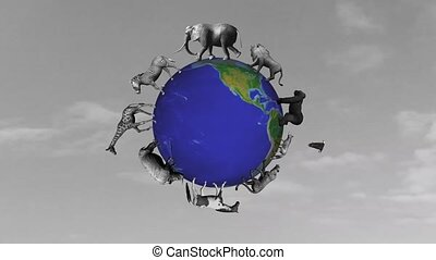 animals circle the world globe in front on grey sky screen