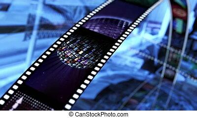 Animated rotating film reels. Black, blue and red 4K - Loop...