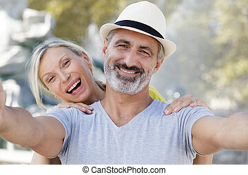 animated senior couple taking selfie